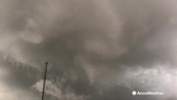 Insane wall cloud rotates above Reed Timmer in tornado-warned storm