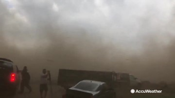 Must see: Tornado literally lands on Reed Timmer while storm chasing
