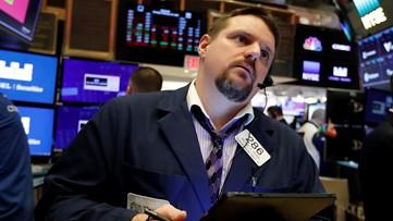 Businesses shudder over virus fears, weeklong stock market rout deepens