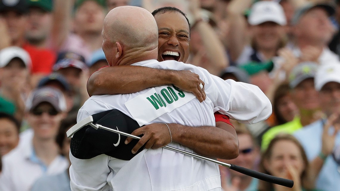 fc04ec35 Tiger Woods reacts with his caddie Joe LaCava as he wins the Masters golf  tournament Sunday, April 14, 2019, in Augusta, Ga. (AP Photo/Marcio Jose  Sanchez)
