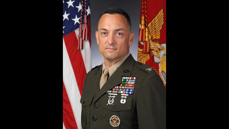 Choir director, priest say commander at Marines' famed Quantico base threatened and terrified them. Marine investigations clear colonel.