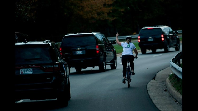 Donald Trump: Woman who gave President's motorcade middle finger sues employer