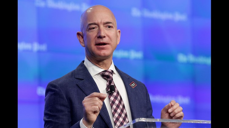 Amazon CEO Jeff Bezos gives a rare live interview on stage at the Economic Club of Washington, D.C., with private equity executive David Rubenstein.