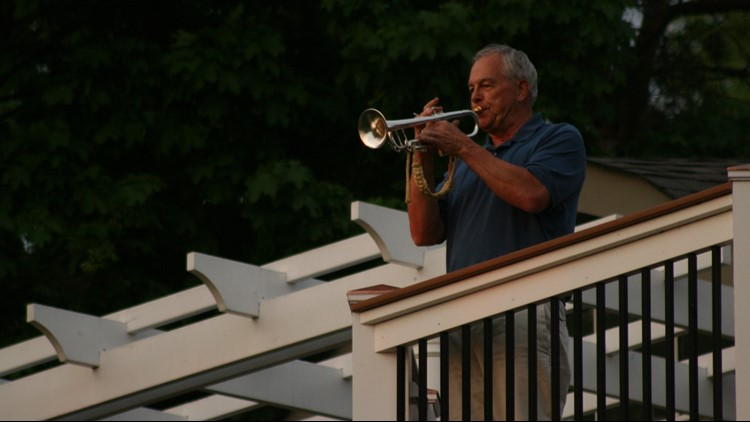 Gary Marquardt plays Taps from the third floor deck of his home