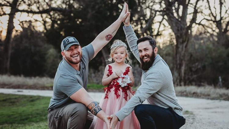 Photographs of two Texas fathers and their daughter goes viral