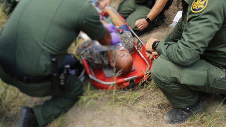 US Border Patrol Agents in s Texas treat an immigrant for heat exhaustion