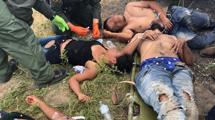 Border Patrol agents rescue a group of immigrants left by their guide in the S Texas brush