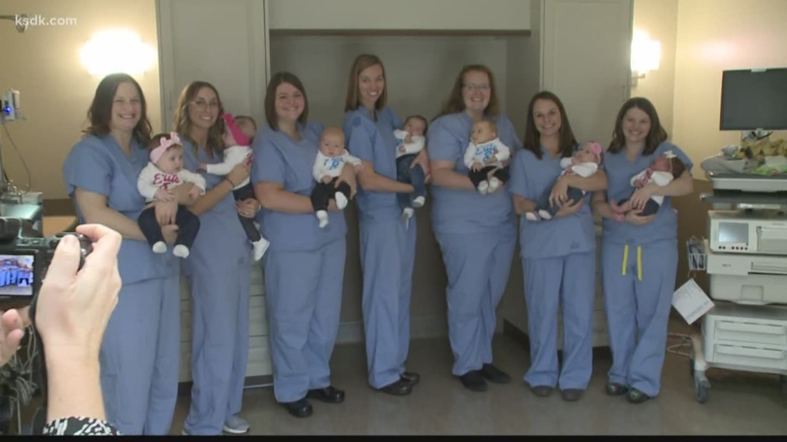 Nurses who were pregnant at the same time hold their babies in adorable photo