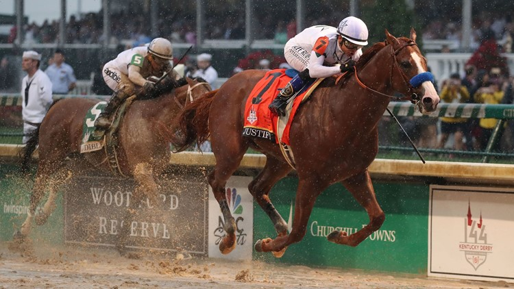 Mike Smith aboard Justify (7) beats Javier Castellano aboard Audible (5) to the finish line to win the 144th running of the Kentucky Derby at Churchill Downs.