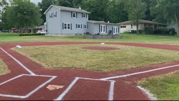 Dad transforms backyard into baseball field for 5-year-old son