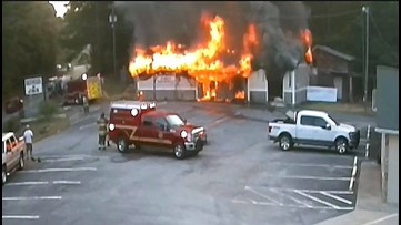 Surveillance video shows Georgia bar owner leaving after setting fire