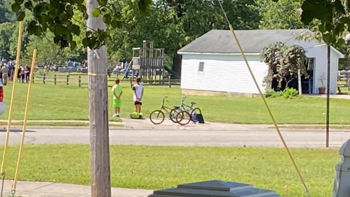 Boys stop bike ride to pay respects at veteran's funeral