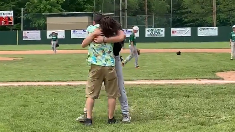 WATCH: Father returns from deployment, surprises son at baseball game