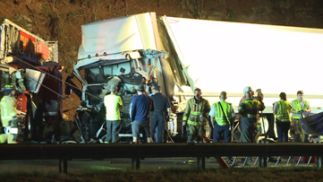 One dead after tractor-trailer smashes into fire truck parked on I-20