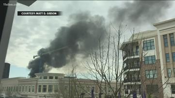 Crane collapses causing massive fire on Alpharetta construction site