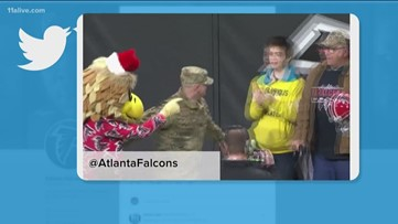 Soldier surprises his family at Falcons game