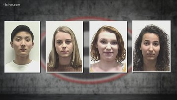 4 charged with vandalizing field at UGA's Sanford Stadium