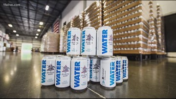 Anheuser-Busch's Cartersville brewery pauses beer production to produce emergency cans of water for Hurricane Michael survivors