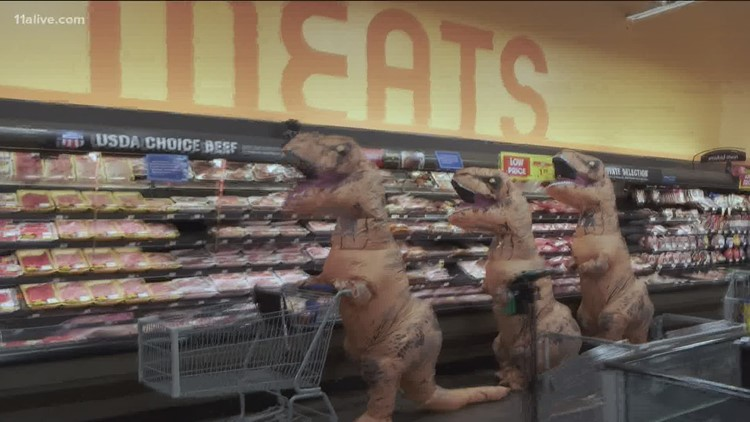 Peachtree City family goes viral after trip to grocery store in inflatable dinosaur costumes