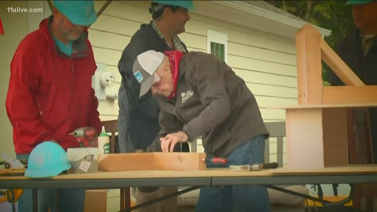 President Jimmy Carter, first lady join country music stars, volunteers at Nashville Habitat build
