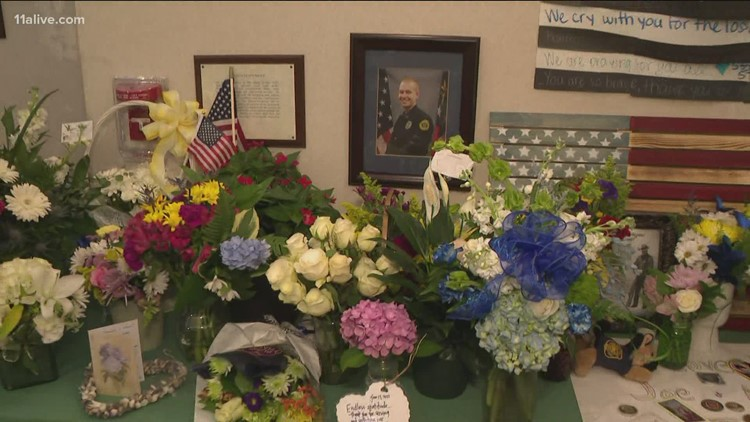 Family, friends gathering to honor fallen Holly Springs officer