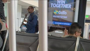 Andre 3000 spotted playing flute at Los Angeles airport