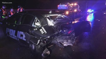 Police officer escapes unharmed after cruiser is smashed by DUI suspect