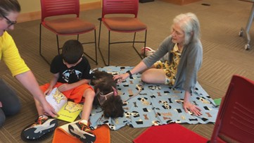Therapy dogs help children 'paws to read'