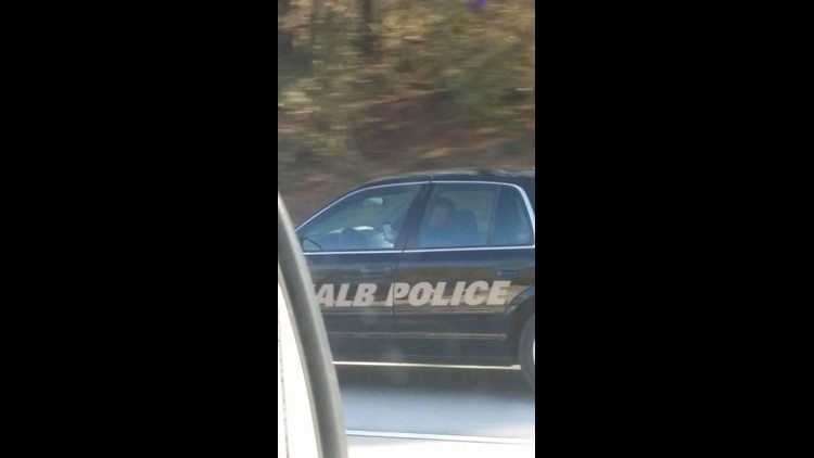 According to state law, police officers are perfectly within their rights to text or operate their computers while driving down the streets.