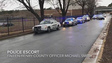 Police procession escorts fallen Henry Co. officer to funeral home