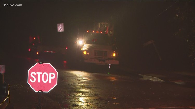 Crews work to clear downed trees following storms