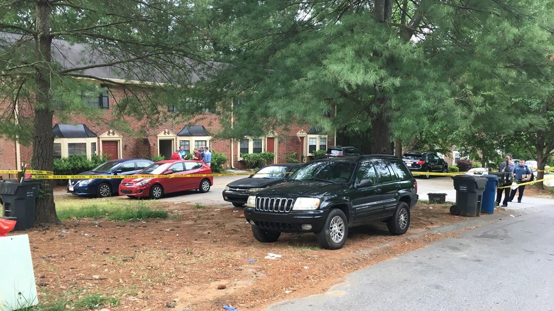 Man found shot to death behind locked door of Lawrenceville home
