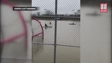 Rome, Georgia baseball team practices on flooded field in kayaks