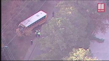 SUV crashes into school bus in Marietta