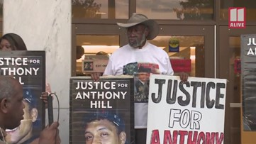 Demonstrators hold rally after jury convicts Robert Olsen in Anthony Hill shooting