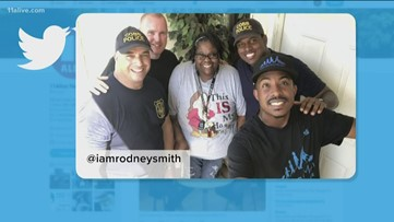 Man mows lawns with officers