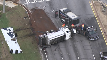 Tanker truck overturns in Clayton County causing heavy delays