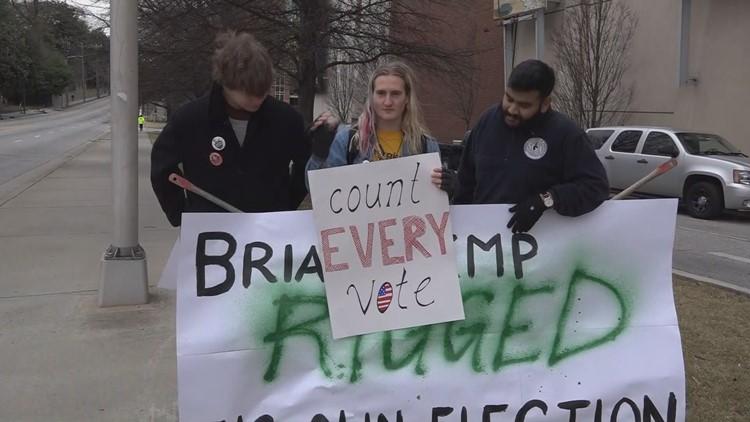 Protesters at Brian Kemp inauguration