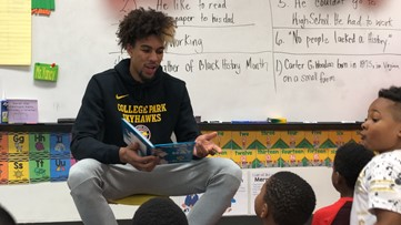 Local basketball team donates more than 500 books to local elementary school