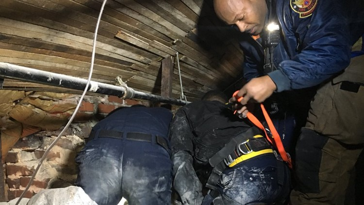 City of Atlanta crews at scene of man stuck in chimney on Feb. 9, 2019