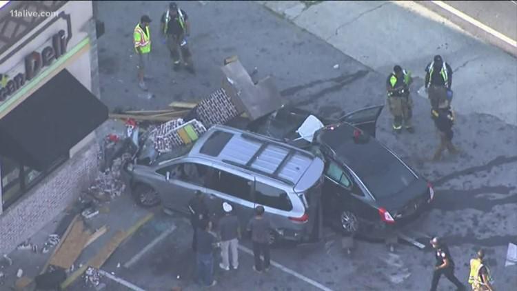 Bricks, debris covering vehicles after crash by American Deli
