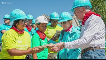Homeowners settling into houses Former President Jimmy Carter help build