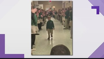 6-year-old who completed last chemo treatment receives standing ovation at school