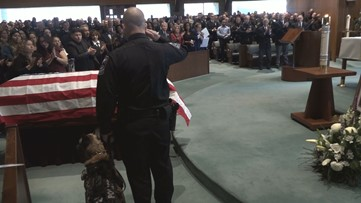 K9 Indi says goodbye to fallen police officer