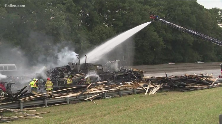 Trucks carrying lumber, 10k pounds of candles collide on I-285, burst into flames