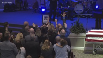 People worship, lift hands at Henry County Officer Michael Smith's funeral