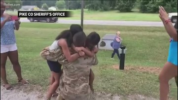 Surprise! Children shocked to see their military dads  home