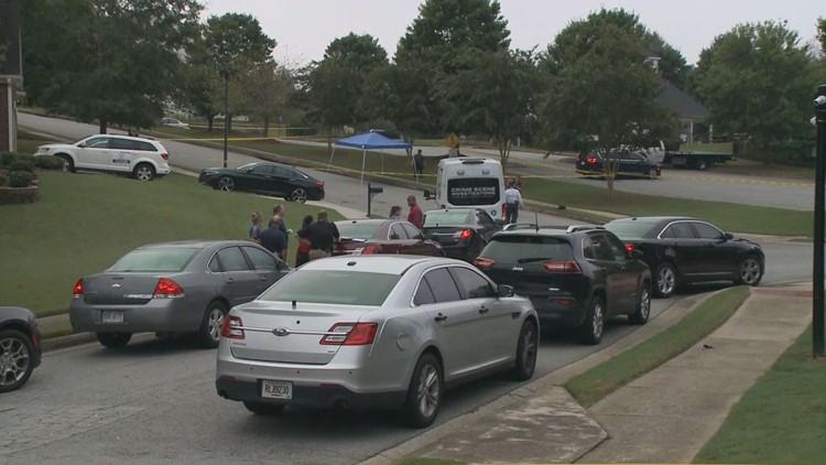 Woman found murdered on Buford neighborhood sidewalk identified; suspect on the run