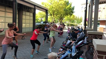 Moms strength train with strollers