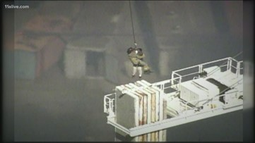 A firefighter rescued a man from a 250-foot crane. 20 years later, the metro Atlanta man is back fighting fires.